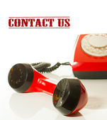 Red old fashioned telephone - Contact us concept — Stock Photo
