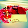 Blank card and two rings and candles - Stock Photo