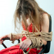 Stock Photo: Womtied up with rope