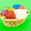 Basket full of the colorful heart shaped toys - Foto Stock