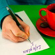 Female's hand writing a life plan — Stock Photo