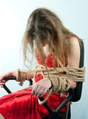 Woman tied up with a rope — Stock Photo