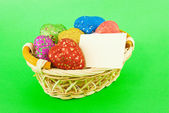 Basket full of the colorful heart shaped toys — Stock Photo