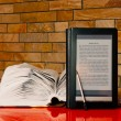Stock Photo: Open book and electronic book reader