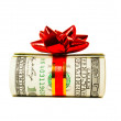 A wad of US one hundred dollar bills tied up with red ribbon — Stock Photo #8982022
