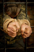 Man with hands tied with rope — Stock Photo