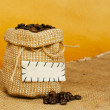 Sack with roasted coffee beans — Stock Photo