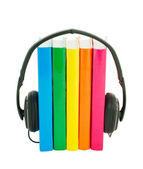 Row of books and headphones - Audiobooks concept — Stock Photo