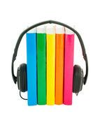 Row of books and headphones - Audiobooks concept — Stock Photo