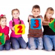 Royalty-Free Stock Photo: Happy kids holding blocks with numbers