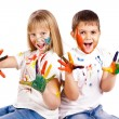 Happy kids with hands painted in colorful paints — Stock Photo