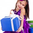 Beautiful little girl with presents — Stock Photo