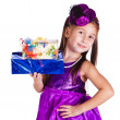 Beautiful little girl with presents — Stockfoto