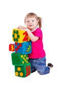 Garota feliz segurando blocos com números — Fotografia Stock