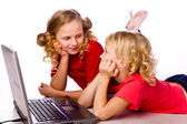 Kids playing computer game on laptop — Stock Photo
