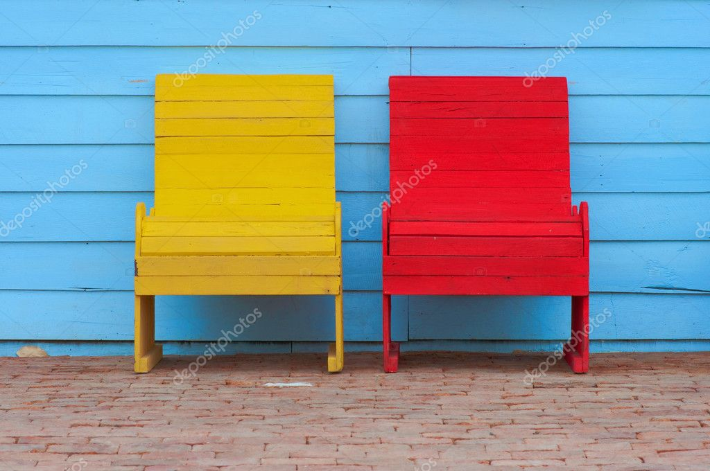 Red and yellow chairs on ancient red brick  Stock Photo #10326888
