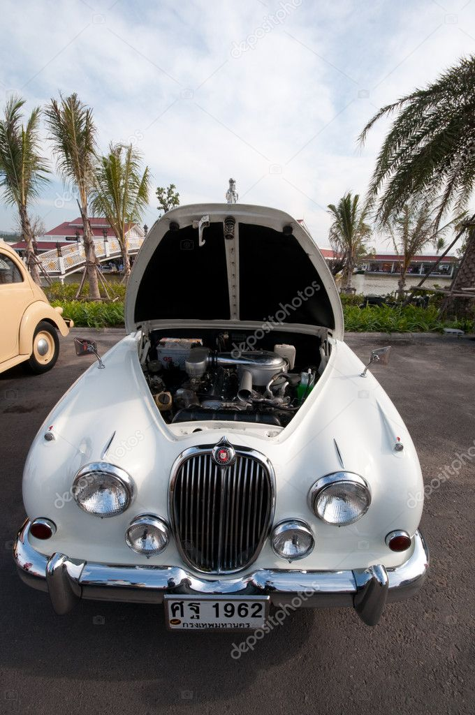 Hua Hin - December 16: Jaguar Vintage cars on display in Hua Hin Vintage Cars Parade Festival 2011 at Hua Hin floating market on December 16, 2011 in Hua Hin, T  Stock Photo #8171934