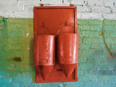 Two old, rusty fire buckets hanging on a wall — Stock Photo