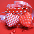 Stock Photo: Red gift box with hearts