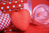 Gift box with ribbon and hearts — Stock Photo
