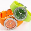 Stock Photo: Green and orange watches
