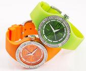 Grün und orange uhren — Stockfoto