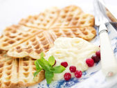 Sweet wafer hearts on dish with cream, berries and mint — Stock Photo
