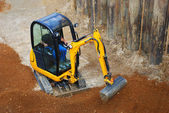 Tiny excavator — Stock Photo