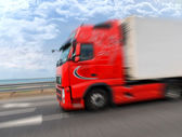 Red truck moving high speed — Stock Photo
