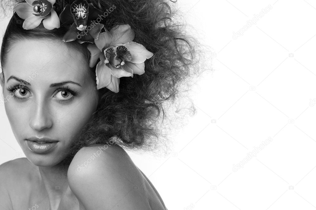 Picture of beautiful woman with orchid flower — Stock Photo #8418274