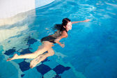 Attractive girl in swimming pool — Foto de Stock