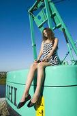 Girl on crane — Stock Photo