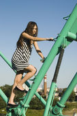 Beautiful girl on crane — Stock Photo