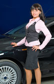Businesswoman in car shop — Stock Photo