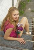 Young woman on stair — Stock Photo