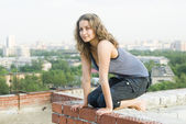 Girl on roof — Stock Photo