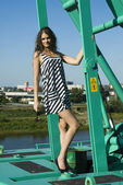Girl on crane — Stock Photo