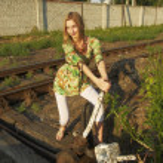 Young woman on railway — Stock Photo