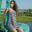 Girl on crane - Lizenzfreies Foto