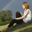 Attractive girl and rainbow — Stock Photo