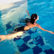 Attractive girl in swimming pool — Stock Photo #9877599