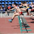 Stock Photo: Girls on the 100 meters hurdles race