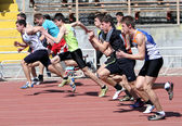 Boys on the 100 meters race — Stock Photo