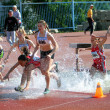 Girls on 2000 meters steeplechase race — Stock Photo #10280938