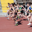 Girls on the 100 meters race - Stock Photo