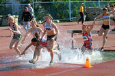 Girls on the 2000 meters steeplechase race — Stock Photo