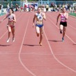 Girls on the 100 meters race — Stock Photo