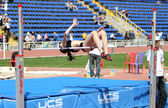 Girl on high jump — Stock Photo