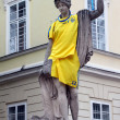 Antique statue dressed in ukrainian national soccer uniform — Stock Photo #10520077