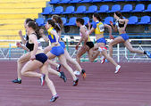 Girls on the start of the 100 meters race — Stock Photo